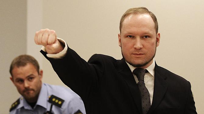 FILE - In this Aug. 24, 2012 file photo, mass murderer Anders Behring Breivik, makes a salute after arriving in the court room at a courthouse in Oslo. Breivik, who admitted killing 77 people in Norway last year, was declared sane and sentenced to prison for bomb and gun attacks. Convicted Norwegian mass-killer Breivik has threatened to go on hunger strike unless he gets access to better video games, a sofa and a larger gym. n a letter received by The Associated Press Tuesday Feb. 18, 2014, Breivik writes the hunger strike will continue until his demands are met or he dies. (AP Photo/Frank Augstein, File)