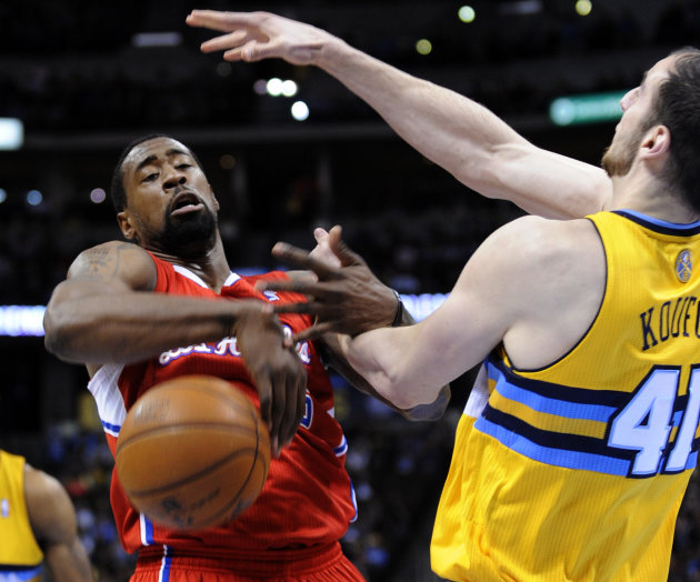 Los Angeles Clippers center DeAndre Jordan (6) loses the ball against Denver Nuggets center Kosta Koufos (41) during the first quarter of an NBA basketball game, Tuesday, Jan. 1, 2013, in Denver. (AP