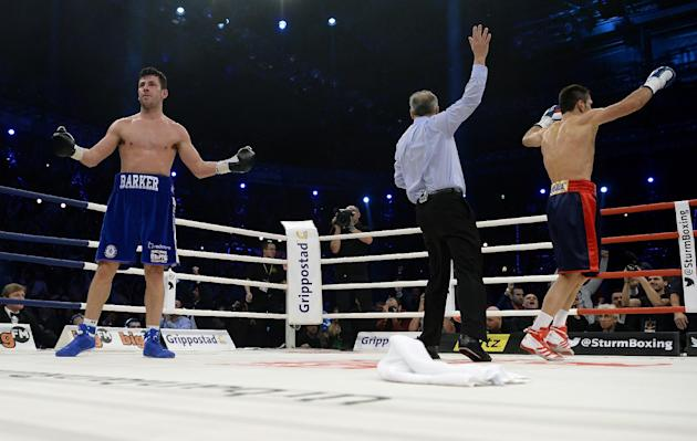 Challenger Felix Sturm from Germany, right, celebrates after defeating Darren Barker of Britain during their middleweight title bout in Stuttgart, southern Germany, Saturday, Dec. 7, 2013.  Sturm defe