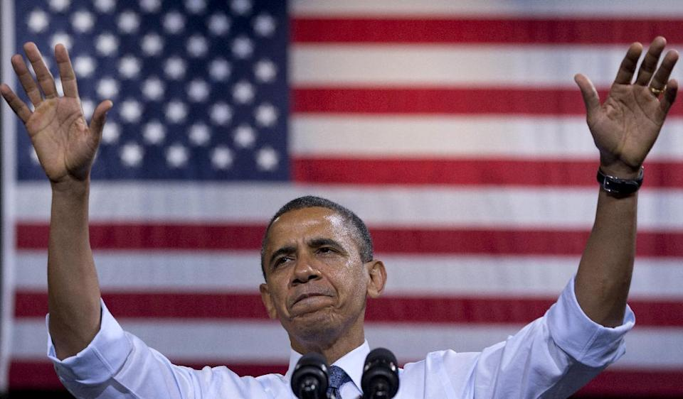 President Barack Obama gestures as he speaks at a campaign event at George Mason University,  Friday, Oct. 5, 2012, in Fairfax, Va. (AP Photo/Carolyn Kaster)