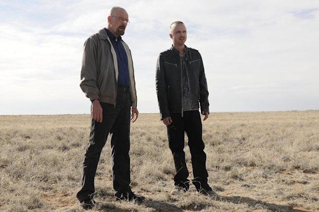 "This image released by AMC shows Bryan Cranston as Walter White, left, and Aaron Paul as Jesse Pinkman in a scene from the season 5 premiere of ""Breaking Bad,"" airing Sunday, July 15, at 10 p.m. EST on AMC. (AP Photo/AMC, Ursula Coyote)"