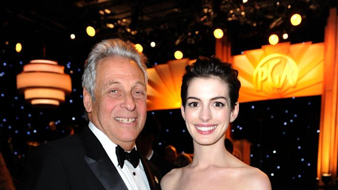 Academy of Motion Picture Arts and Sciences President Hawk Koch, left, and actress Anne Hathaway attend the 24th Annual Producers Guild (PGA) Awards at the Beverly Hilton Hotel on Saturday Jan. 26, 2013, in Beverly Hills, Calif. (Photo by Jordan Strauss/Invision for Producers Guild/AP Images)