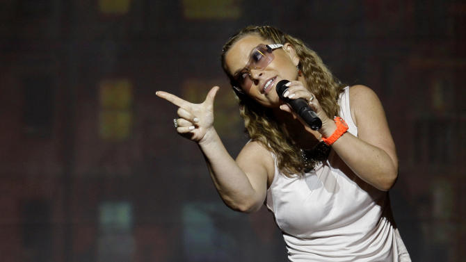 FILE - In this July 25, 2009 file photo,  Anastacia performs during her concert  in Lisbon, Portugal.  Managers for Anastacia say she has canceled a planned performance in Dubai and an upcoming European tour after being diagnosed with breast cancer.  A statement Thursday, Feb. 28, 2013,  says the 44-year-old performer will cancel all appearances and travel until further notice. Anastascia, who has had multi-platinum album sales in Europe, Australia and elsewhere, was scheduled to perform March 30 at the Dubai World Cup, the world's richest horse race.  She successfully battled breast cancer in 2003.(AP Photo/Armando Franca)