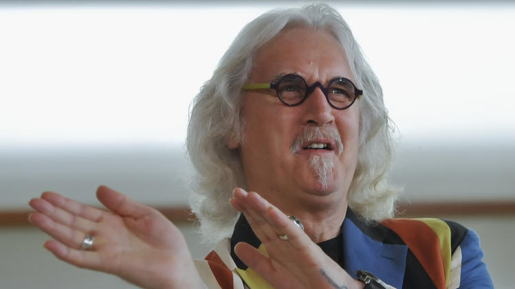 "FILE - Scottish actor and comedian Billy Connolly jokes at the 60th San Sebastian Film Festival, Spain, in this Saturday Sept. 29, 2012 file photo. A spokesman said Monday Sept 16 2013 that Connolly has had surgery for early stages of prostate cancer and is also receiving treatment for initial symptoms of Parkinson's Disease. The statement says the 70-year-old star is ""fully recovered"" from prostate surgery in the United States. (AP Photo/Alvaro Barrientos, file)"