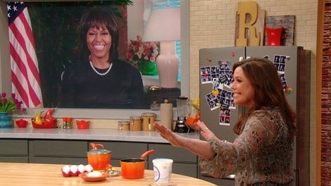 The first lady tells Rachael Ray that the bangs were part of her mid-life crisis. (Photo: CBS)