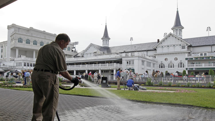 Franklin Best hoses down the paddock area before the 138th Kentucky Derby horse race at Churchill Downs Saturday, May 5, 2012, in Louisville, Ky. (AP Photo/Mark Humphrey)