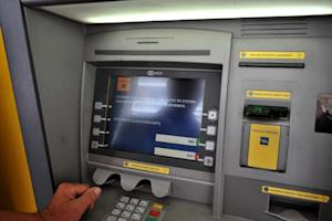 An ATM machine displays a message which translates …