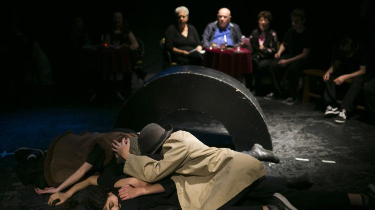 Israeli teenagers and Holocaust survivors perform during a dress rehearsal, part of an educational project, near Tel Aviv