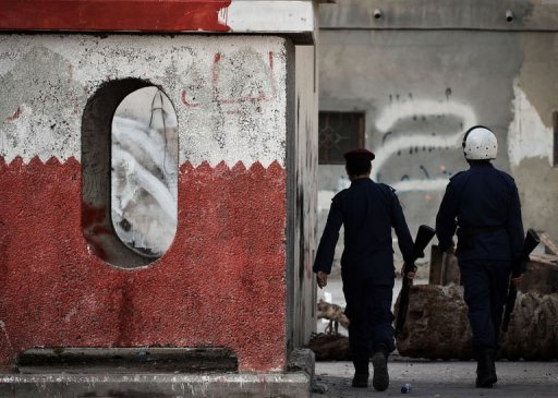 Bahraini security forces keep watch during clashes with Shiite Muslim protestors following a demonstration in solidarity with jailed human rights activists in the village of Malikiyah, south of of Manama, on January 7, 2013. The upholding by Bahrain&#39;s highest appeals court of lengthy prison terms against 13 opposition activists is &quot;mind-boggling&quot;, Human Rights Watch said Tuesday,