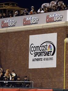 Glue is seen on the brick facade in right center field (to the left of the Comcast sign) where a plaque commemorating Barry Bonds' 756 home run was affixed seen during the Arizona Diamondbacks vs. San Francisco Giants baseball game Tuesday, April 23, 2013, in San Francisco. The plaque has been missing for about a week. (AP Photo/Ben Margot)