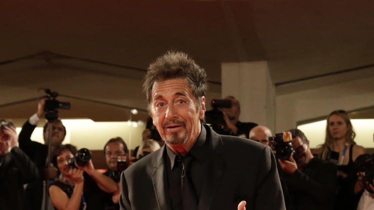 Actor Al Pacino poses for photographers as he arrives for the screening of The Humbling during the 71st edition of the Venice Film Festival in Venice, Italy, Saturday, Aug. 30, 2014. (AP Photo/David Azia)