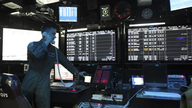 A U.S. marine operates at the flight control centre of USS George Washington during military manoeuvre exercises, known as Keen Sword 15, between the U.S. and Japanese Self-Defense Force in the sea south of Japan