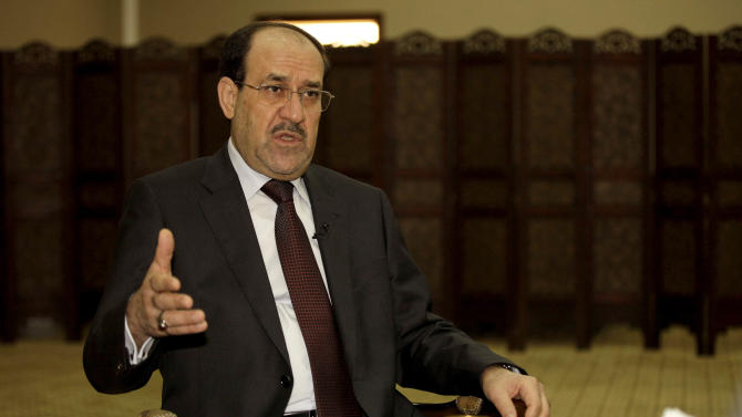 Iraq's Prime Minister Nouri al-Maliki speaks during an interview with The Associated Press in Baghdad, Iraq, Wednesday, Feb. 27, 2013. Al-Maliki warns that a victory for rebels fighting to overthrow the Syrian President Bashar Assad would spark a sectarian war in his own country and Lebanon, and create a new haven for extremists that would destabilize the wider Middle East. (AP Photo/ Khalid Mohammed)