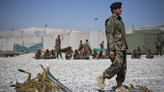 An Afghan National Army soldier waits for the start of the hand over ceremony of the Parwan Detention Facility from U.S. military control to Afghan authorities in Bagram, outside Kabul, Afghanistan, Monday, March 25, 2013. The handover of Parwan Detention Facility ends a bitter chapter in American relations with Afghanistan's mercurial president, Hamid Karzai, who demanded control of the prison as a matter of national sovereignty. (AP Photo/Anja Niedringhaus)
