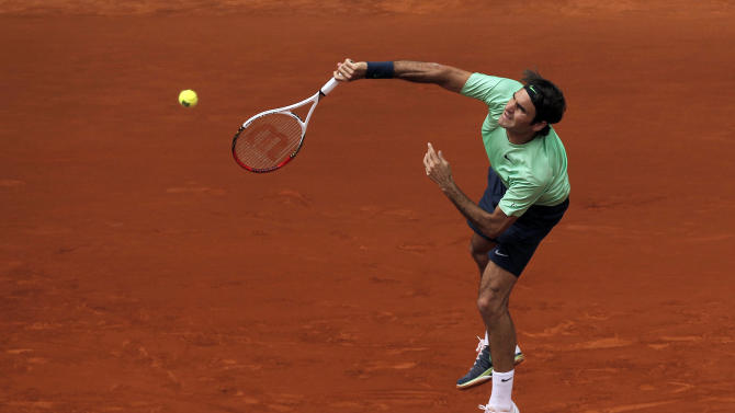 Roger Federer from Switzerland serves during the match against Radek Stepanek from Czech Republic at the Madrid Open tennis tournament, in Madrid, Tuesday May 7, 2013. (AP Photo/Andres Kudacki)
