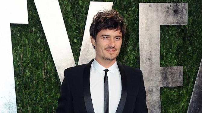 "FILE - In this Feb. 24, 2013 file photo, actor Orlando Bloom arrives at the 2013 Vanity Fair Oscars Viewing and After Party at the Sunset Plaza Hotel in West Hollywood, Calif. Bloom and Condola Rashad will star in a modern take on William Shakespeare's ""Romeo and Juliet"" on Broadway this fall. Producers said Monday, April 1, 2013, that previews at the Richard Rodgers Theatre begin Aug. 24, with an opening night set for Sept. 19.  (Photo by Jordan Strauss/Invision/AP, File)"