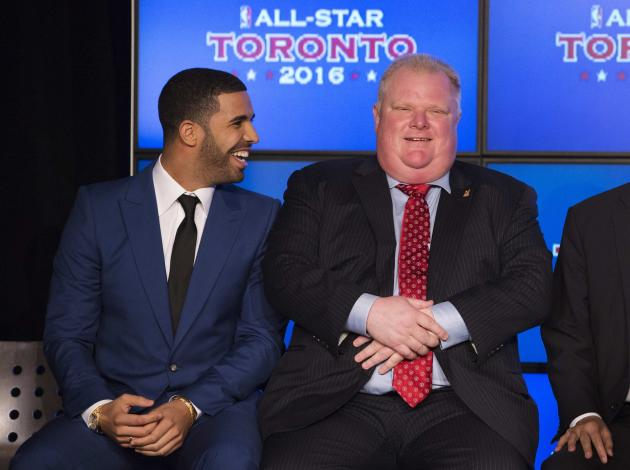 Rapper Drake sits with Toronto Mayor Ford during an announcement that the Toronto Raptors will host the 2016 NBA All-Star game in Toronto