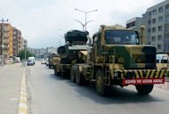Turkish military trucks transport missile batteries through Hatay on June 28. Turkey has sent missile batteries and army vehicles to the border with Syria. The bodies of the two pilots of a Turkish fighter jet that was downed by Syria last month have been recovered at the bottom of the eastern Mediterranean sea, the Turkish army said Wednesday