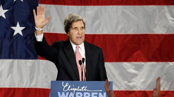 FILE - This Nov. 6, 2012 file photo shows Senate Foreign Relations Committee Chairman, Sen. John Kerry waveing after speaking during an election night rally for Sen.-elect Elizabeth Warren, D-Mass. Big changes are coming to the Obama administration _ just not right away. The White House is making the high-stakes fiscal cliff its top priority before President Barack Obama decides major Cabinet changes at Treasury, the State Department and the Pentagon  (AP Photo/Michael Dwyer, File)