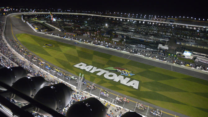 Brennan Newberry (14) and Justin Lofton (6) lead the pack of racers to the green flag for the start of the NASCAR Truck Series auto race at Daytona International Speedway in Daytona Beach, Fla., Friday, Feb. 22, 2013. (AP Photo/Phelan M. Ebenhack)