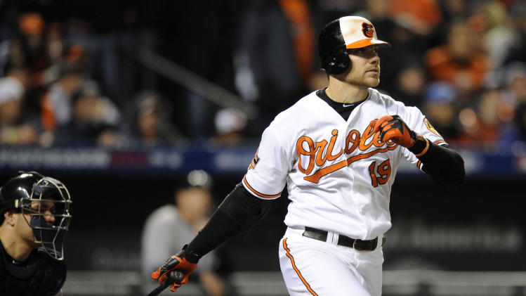 Baltimore Orioles' Chris Davis singles in the third inning of Game 2 of the American League division baseball series against the New York Yankees on Monday, Oct. 8, 2012, in Baltimore. Robert Andino and Nate McLouth scored on the play. (AP Photo/Nick Wass)