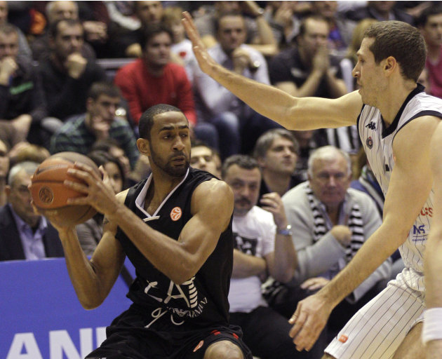 Drew Nicholas of EA7 Emporio Armani, left, drives to the basket as he is guarded by Dusan Kecman of Partizan Belgrade during their Group C Euroleague basketball match in Belgrade, Serbia, Thursday, De