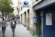 People walk past a Pole Emploi agency, France's employment agency, on September 3, 2012 in Paris. Unemployment continues to rise in France, with the number of jobseekers hitting the symbolic number of three million.