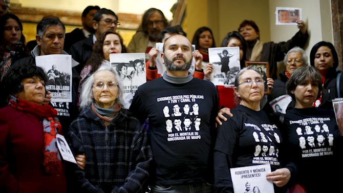 "Relatives of the Gallardo family, six of whom died during the dictatorship of Augusto Pinochet in a human rights case known as ""Rinconada de Maipu"", stand inside Chile's Supreme Court building at Santiago"