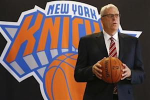 Phil Jackson poses during news conference announcing him as the team president of the New York Knicks basketball team at Madison Square Gardens in New York