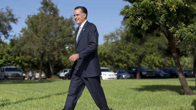 Republican presidential candidate, former Massachusetts Gov. Mitt Romney leaves the Church of Jesus Christ of Latter Day Saints after service on Sunday, Oct. 21, 2012 in Boca Raton, Fla.  (AP Photo/ Evan Vucci)
