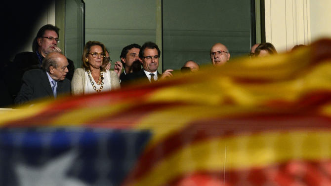 The leader of the center-right Catalan Nationalist Coalition (CiU), Artur Mas, center, looks at the crowd following his election results in Barcelona, Spain, Sunday, Nov. 25, 2012. The economically powerful region of Catalonia has voted into office a large majority of pro-independence lawmakers, but the leader who made a referendum over breaking away from Spain a central plank of his campaign saw his party's majority reduced by 12 seats. (AP Photo/Manu Fernandez)