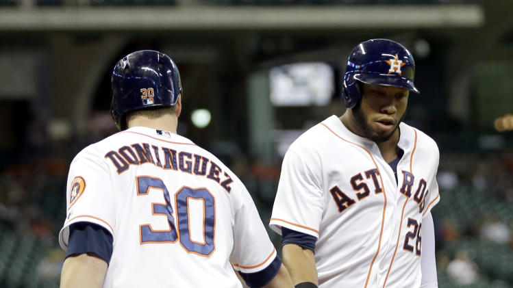 Houston Astros' Jon Singleton, right, is congratulated by Matt Dominguez (30) after hitting a home run against the Toronto Blue Jays during the second inning of a baseball game Thursday, July 31, 2014, in Houston. (AP Photo/David J. Phillip)