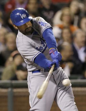 Los Angeles Dodgers' Matt Kemp hits a double off of San Francisco Giants pitcher Barry Zito to score Yasiel Puig during the fourth inning of a baseball game in San Francisco, Wednesday, Sept. 25, 2013. (AP Photo/Jeff Chiu)