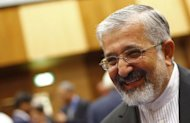 "Iran's envoy to the International Atomic Energy Agency (IAEA) Ali Asghar Soltanieh smiles as he attends the UN atomic agency members meeting in Vienna on September 10. Iran should ""understand the message"" that it needs to do more to address global concerns that it wants the bomb, following the UN atomic agency's latest board resolution, the watchdog's chief told AFP"
