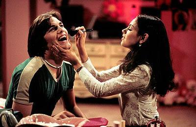 "Jackie (Mila Kunis, R) persuades Kelso (Ashton Kutcher, L) to go glam on ""The Velvet Rope"" episode of Fox's That 70s Show"