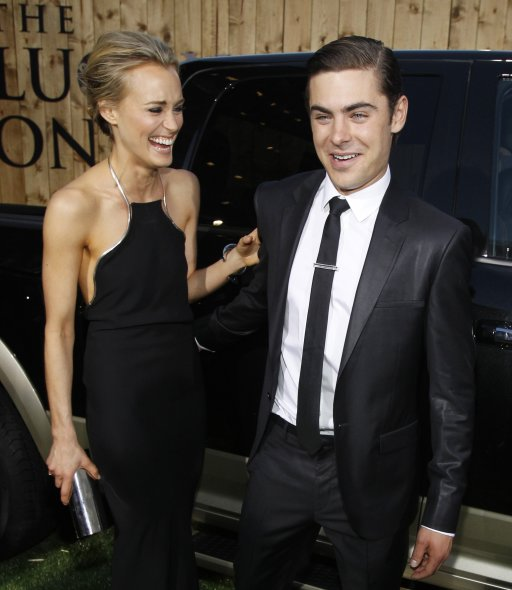"Efron and co-star Taylor Schilling attend the premiere of ""The Lucky One"" at the Grauman's Chinese theatre in Hollywood"