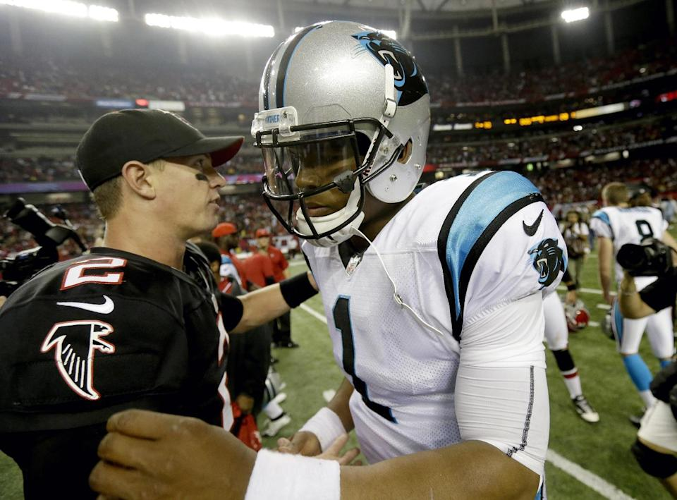 Carolina Panthers quarterback Cam Newton (1) talks with Atlanta Falcons quarterback Matt Ryan (2) following a 30-28 win by the Falcons over the Panthers in their NFL football game at the Georgia Dome in Atlanta Sunday, Sept. 30, 2012. (AP Photo/David Goldman)