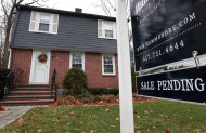 <p>               In this Dec. 27, 2011 photo, a sale pending sign hangs in front of a single-family home in Brookline, Mass. The number of Americans who signed contracts to buy homes in November rose to the highest level in a year and a half. (AP Photo/Steven Senne)