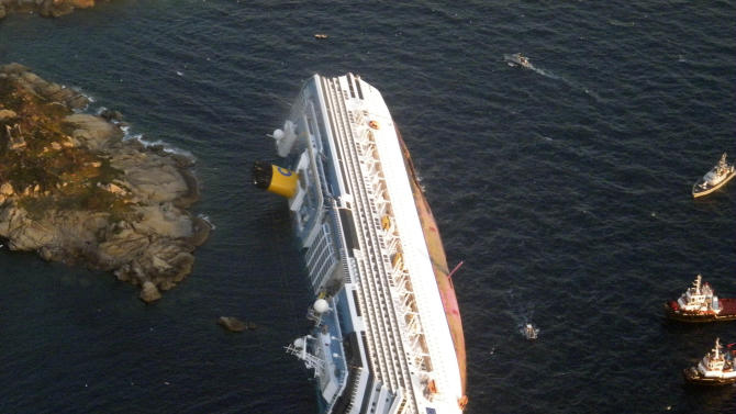 FILE - In this Jan. 14, 2012 file photo provided by the Guardia di Finanza (border Police), the luxury cruise ship Costa Concordia leans on its side after running aground off the tiny Tuscan island of Giglio, Italy. A judge in Tuscany fined Italian cruise line Costa Crociere SpA 1 million euros ($1.3 million) Wednesday, April 10, 2013 for the shipwreck that killed 32 people. (AP Photo/Guardia di Finanza, File)
