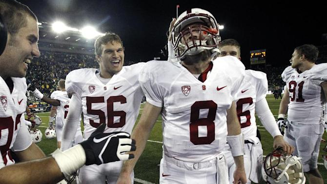 Stanford quarterback Kevin Hogan (8) is congratulated by teammates after winning their NCAA college football game against Oregon in overtime 17-14. in Eugene, Ore., Saturday, Nov. 17, 2012.(AP Photo/Don Ryan)