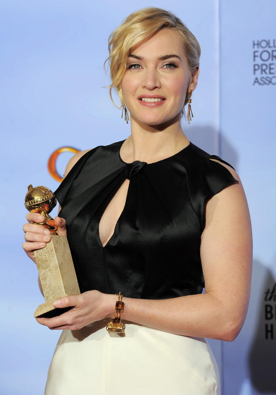 "Actress Kate Winslet poses backstage with the award for Best Actress in a Mini Series or TV Movie for ""Mildred Pierce"" during the 69th Annual Golden Globe Awards Sunday, Jan. 15, 2012, in Los Angeles. (AP Photo/Mark J. Terrill)"