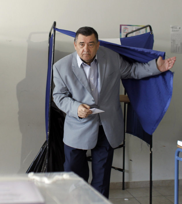 Leader of the right-wing LAOS party George Karatzaferis exits a polling booth at a polling station in Athens, on Sunday, June 17 2012.  Greeks are voting Sunday for the second time in six weeks in wha