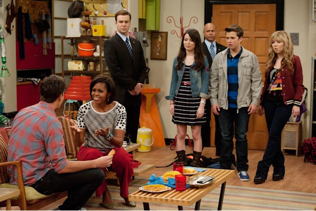 In this undated image released by Nickelodeon, first lady Michelle Obama. seated second left, interacts with Jerry Trainor, left, as Miranda Cosgrove, center, Nathan Kress and Jennette McCurdy, right,