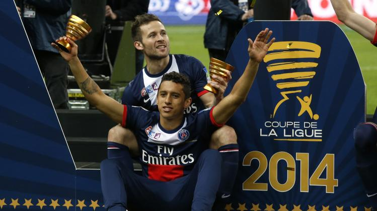 Paris St Germain's Cabaye and Marquinhos celebrate winning the French League Cup final soccer match in Saint-Denis