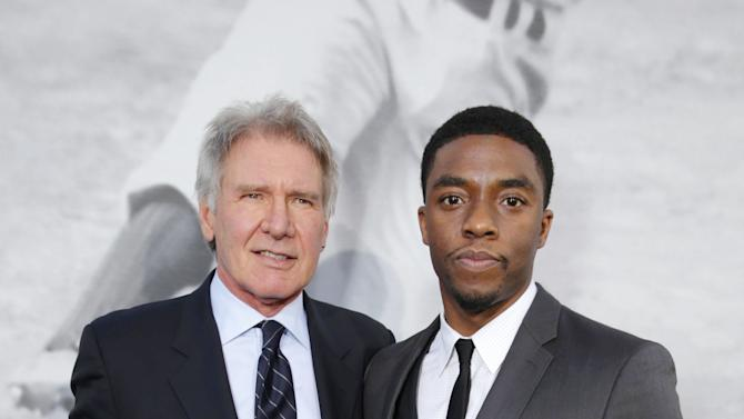Harrison Ford and Chadwick Boseman at The Los Angeles Premiere of Warner Bros. Pictures' and Legendary Pictures' 42, on Tuesday, April, 9th, 2013 in Los Angeles. (Photo by Eric Charbonneau/Invision for Warner Bros./AP Images)