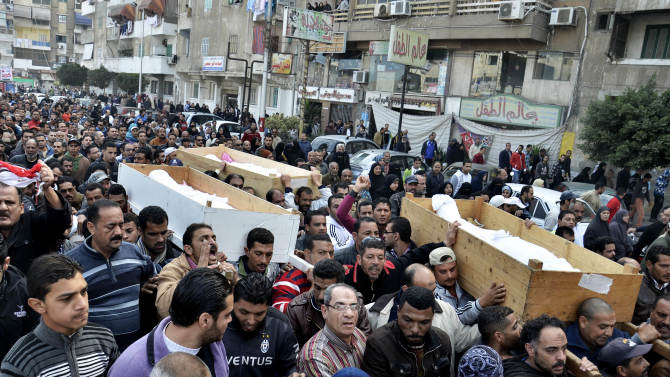 Egyptians attend the funeral of several Sunday victims of ongoing violence in Port Said, Egypt, Monday, Jan. 28, 2013. The worst violence in Egypt this past weekend was in the Mediterranean coastal city of Port Said, where at least 44 people died in two days of clashes. The unrest was sparked on Saturday by a court conviction and death sentence for 21 defendants involved in a mass soccer riot in the city's main stadium on Feb. 1, 2012 that left 74 dead. (AP Photo)