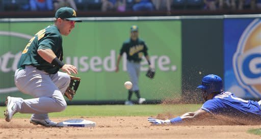 A's overcome disputed call to beat Rangers 5-4