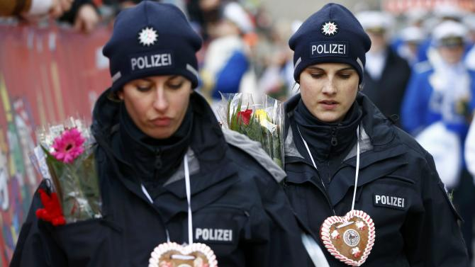 "German police officers walk during the ""Rosenmontag"" (Rose Monday) parade, the highlight of the annual carnival season in Cologne"