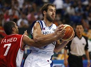 Greece's Spanoulis is challenged by Lebanon's Fahed during their FIBA Olympic qualifying tournament basketball game in Athens