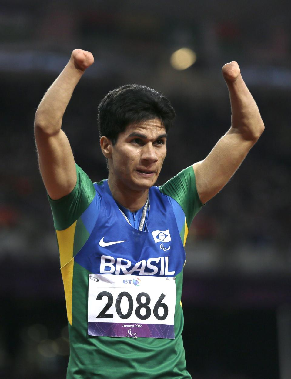 Brazil's Yohansson Nasciemento celebrates winning gold in the men's 200m T46 final at the 2012 Paralympics, Sunday, Sept. 2, 2012, in London. (AP Photo/Kirsty Wigglesworth)